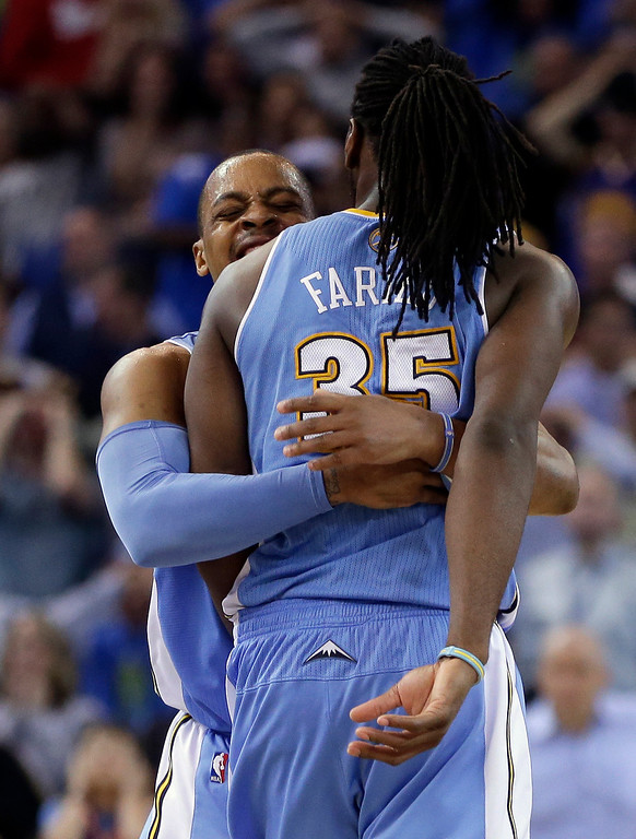 . Denver Nuggets\' Kenneth Faried (35) is embraced by Randy Foye after Faried made the game-winning shot against the Golden State Warriors during the second half of an NBA basketball game Thursday, April 10, 2014, in Oakland, Calif. Denver won 100-99. (AP Photo/Ben Margot)