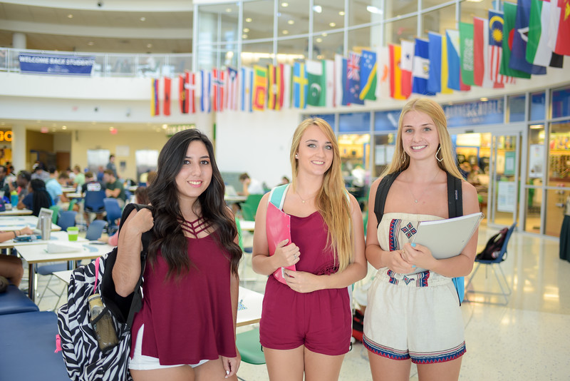 Savannah Marisio (left), Jille Diethman and Kayla Buhr hang out in the UC before their classes start.
