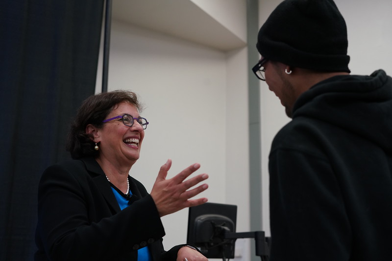 Sonia Nazario speaks with a student.