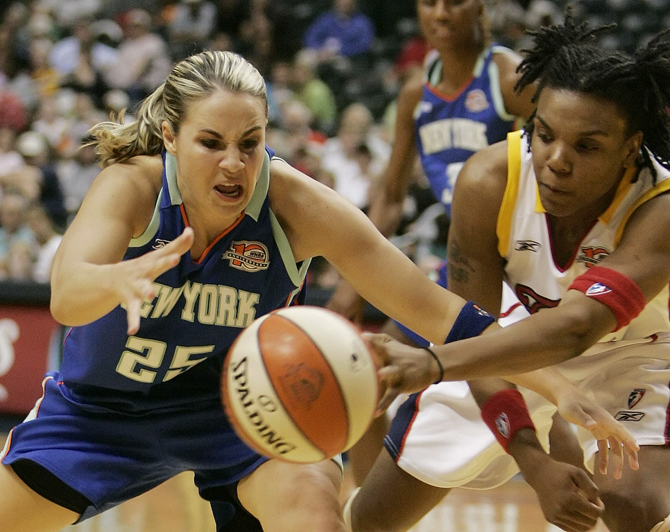 . New York Liberty guard Becky Hammon, left, and  Indiana Fever guard Tan White battle for a loose ball during the third quarter of a WNBA basketball game in Indianapolis, Tuesday, May 30, 2006. Indiana defeated New York 91-70. (AP Photo/Darron Cummings)