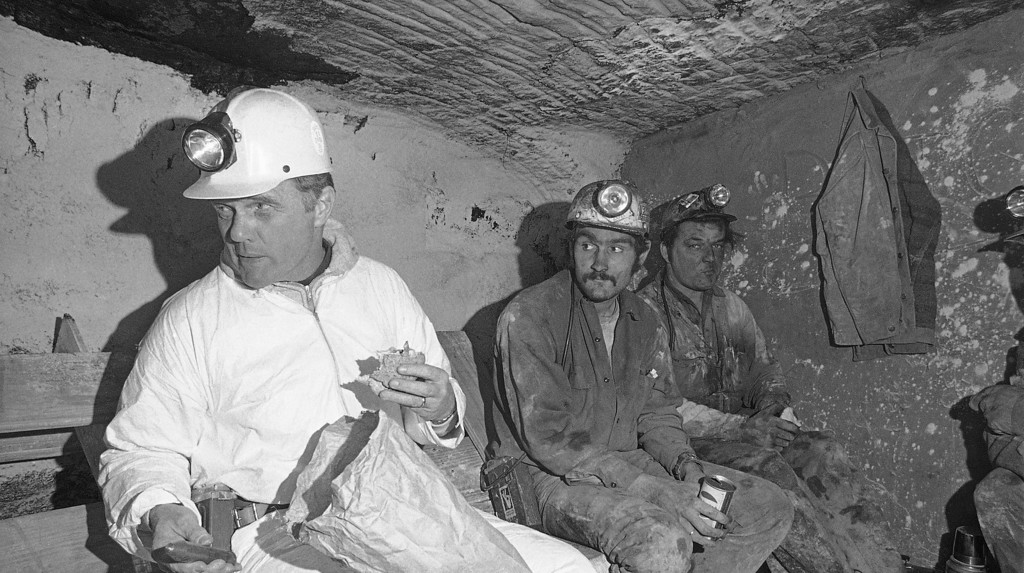 . Former Astronaut John Glenn, left, joins coal miners during their lunch break deep in Oak Park Mine #7 near Cadiz, Ohio, Feb. 8, 1974, during a day of campaigning. Glenn is seeking the Democratic nomination in his second bid for the U.S. Senate. (AP Photo/Steve Pyle)