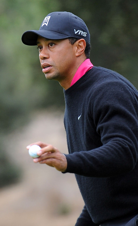 . Tiger Woods acknowledges the crowd after sinking a birdie putt on the first hole during the second round of the Northwestern Mutual World Challenge golf tournament at Sherwood Country Club, Friday, December 6, 2013, in Thousand Oaks, Calif. (Andy Holzman/Los Angeles Daily News)