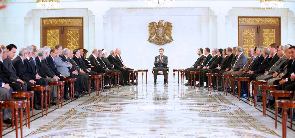 . Syria\'s President Bashar al-Assad (C) meets a Lebanese delegation representing national parties, forces and figures in Damascus, in this handout photograph distributed by Syria\'s national news agency SANA on April 21, 2013. REUTERS/SANA/Handout