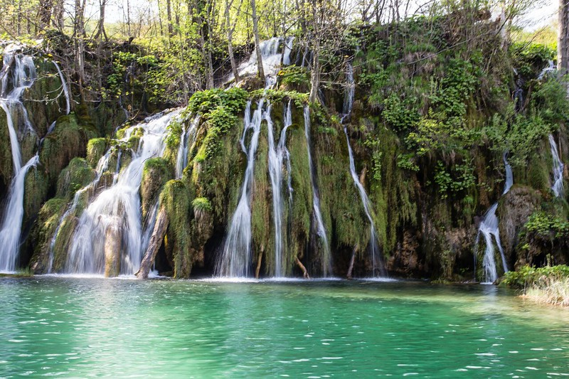 Watefalls streaming down a green bank in Croatia.