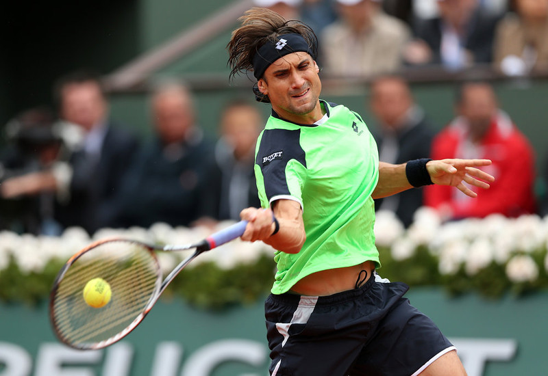 . David Ferrer of Spain plays a forehand during the Men\'s Singles final match against Rafael Nadal of Spain during day fifteen of the French Open at Roland Garros on June 9, 2013 in Paris, France.  (Photo by Clive Brunskill/Getty Images)