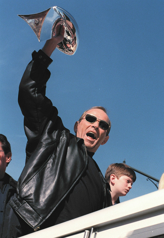 . Broncos owner Pat Bowlen showeing off the Vince Lombardi  Trophy during the parade. He and his family rode atop a  fire truck at the beginning of the parade in 1997.  Karl Gehring, The Denver Post