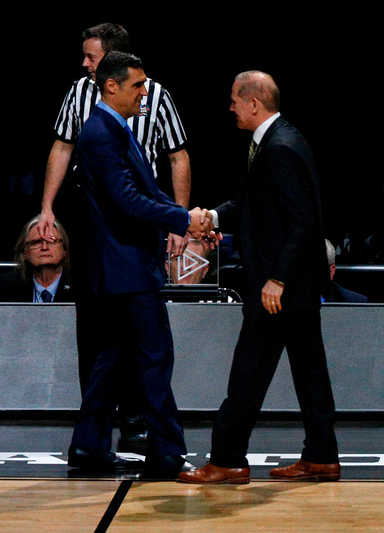 . Villanova head coach Jay Wright, left, greets Michigan head coach John Beilein before the championship game of the Final Four NCAA college basketball tournament, Monday, April 2, 2018, in San Antonio. (AP Photo/Brynn Anderson)