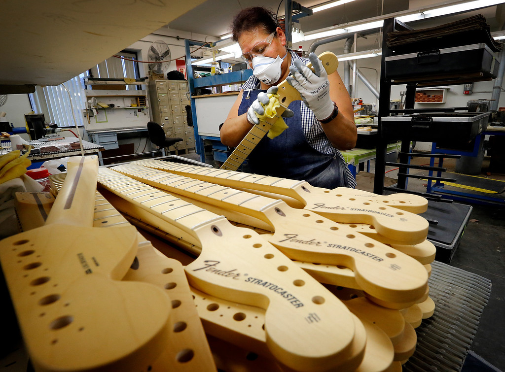 . Fender Stratocaster necks are prepared for assembly at the Fender factory in Corona, Calif. on Tuesday, Oct. 15, 2013. The instrument, used by countless professional and amateur musicians, celebrates it\'s 60th anniversary in 2014. (AP Photo/Matt York)