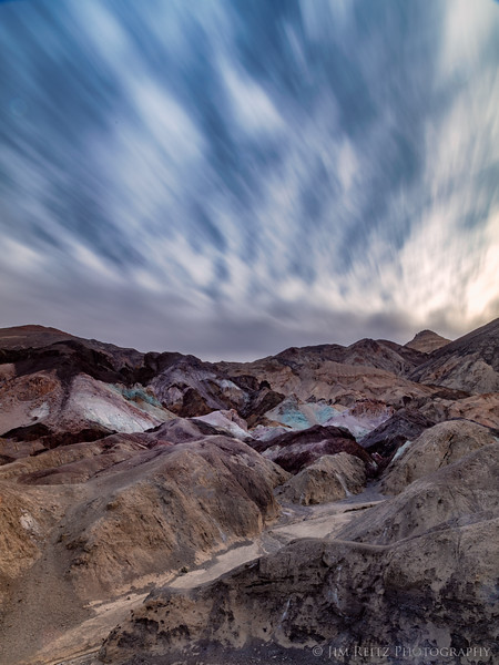 Long-exposure shot in Death Valley, at Artist's Palette - an amazing array of colored minerals exposed on the side of a mountain.