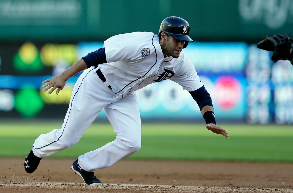 . Detroit Tigers\' J.D. Martinez dives back to first during the second inning of a baseball game against the Tampa Bay Rays in Detroit, Friday, July 4, 2014. (AP Photo/Carlos Osorio)