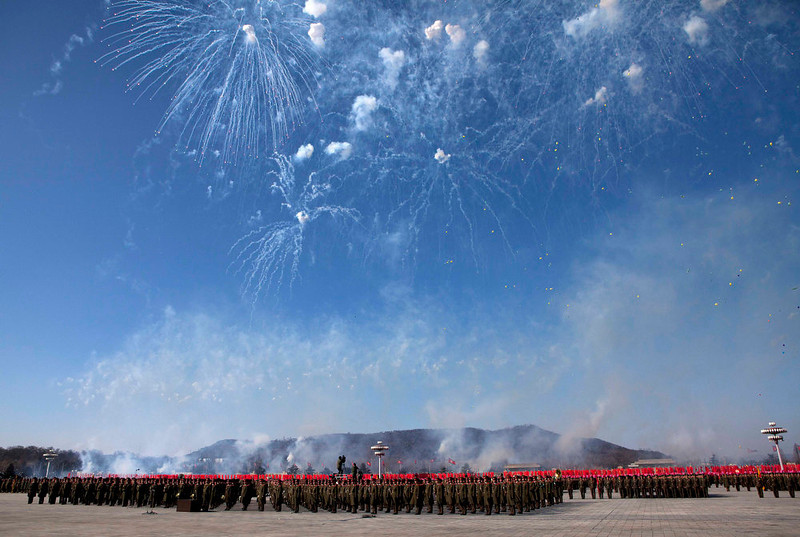 . Fireworks explode over the heads of North Korean soldiers lined up in formation at Kumsusan Memorial Palace in Pyongyang during a parade of thousands of soldiers commemorating the 70th birthday of the late Kim Jong Il on Feb. 16, 2012.  (AP Photo/David Guttenfelder)