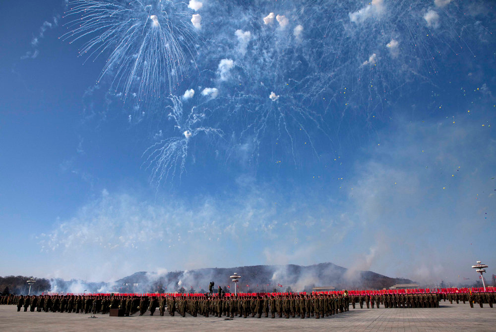 Description of . Fireworks explode over the heads of North Korean soldiers lined up in formation at Kumsusan Memorial Palace in Pyongyang during a parade of thousands of soldiers commemorating the 70th birthday of the late Kim Jong Il on Feb. 16, 2012.  (AP Photo/David Guttenfelder)