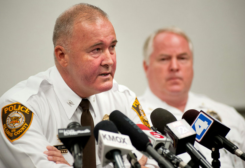 . St. Louis County Police Chief Jon Belmar, left, delivers remarks as Ferguson Police Chief Thomas Jackson listens during a news conference Sunday, Aug. 10, 2014 in Ferguson, Mo., where the men addressed issues surrounding the shooting of Michael Brown, 18, by Ferguson police Saturday, Aug. 9, 2014. Brown died following a confrontation with police, according to Belmar. (AP Photo/Sid Hastings)