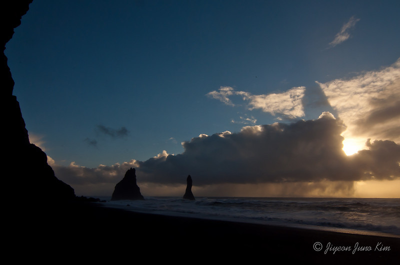 Reynisfjara beach with columnar basalt formations and ocean carved caves