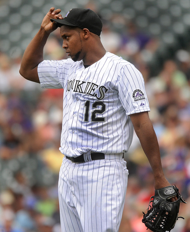 . Colorado pitcher Juan Nicasio reacted after recording a strike out. The Colorado Rockies hosted the Miami Marlins at Coors Field Thursday afternoon, July 25, 2013. Photo By Karl Gehring/The Denver Post