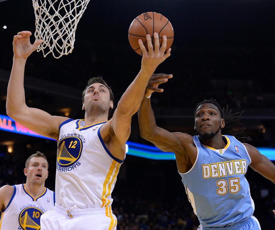 . Golden State Warriors center Andrew Bogut of Australia (C) and Denver Nuggets power forward Kenneth Faried (R) reach-out for a rebound during the first half of their NBA game at Oracle Arena in Oakland, California, USA, 15 January 2014.  EPA/JOHN G. MABANGLO CORBIS OUT