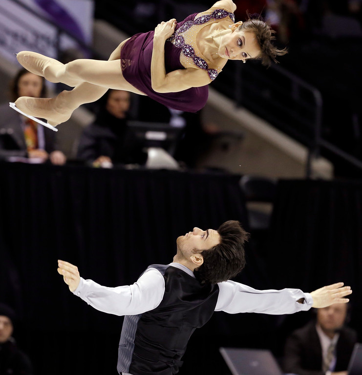 . Meagan Duhamel and Eric Radford, of Canada, perform during the pairs free program at the World Figure Skating Championships Friday, March 15, 2013, in London, Ontario. (AP Photo/Darron Cummings)