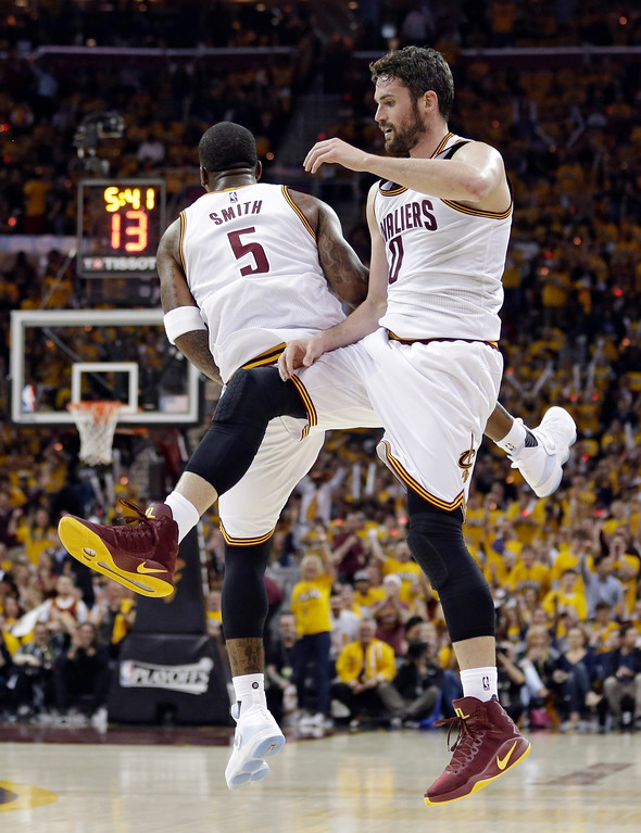 . Cleveland Cavaliers\' Kevin Love (0) and J.R. Smith (5) celebrate in the first half in Game 1 of a second-round NBA basketball playoff series against the Toronto Raptors, Monday, May 1, 2017, in Cleveland. The Cavaliers won 116-105. (AP Photo/Tony Dejak)