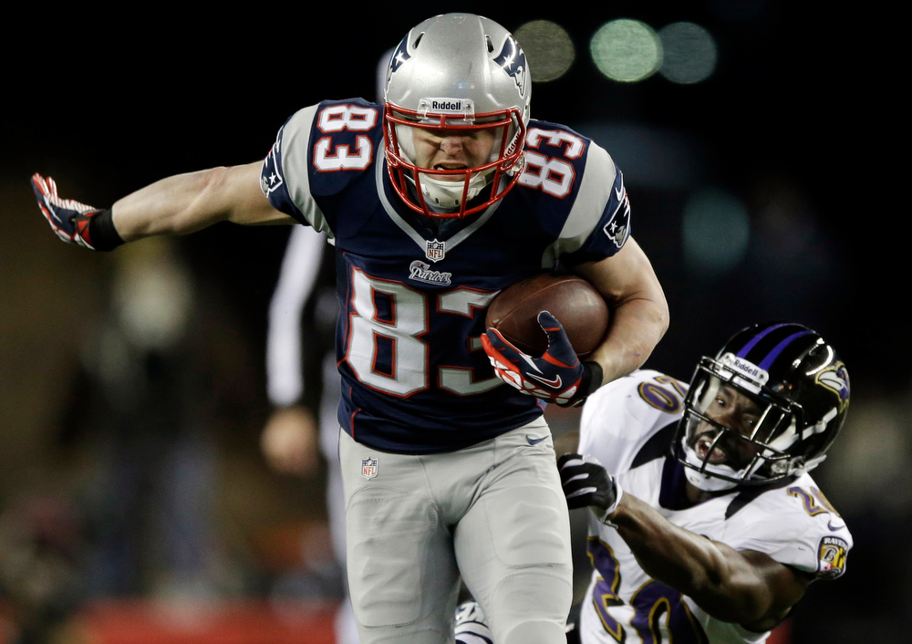 . In this Jan. 20, 2013, file photo, New England Patriots wide receiver Wes Welker (83) runs out of the tackle of Baltimore Ravens free safety Ed Reed (20) during the first half of the AFC championship NFL football game in Foxborough, Mass. (AP Photo/Matt Slocum, File)