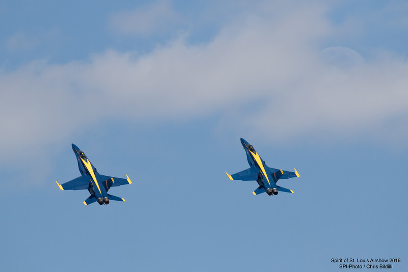 Blue Angels 5 and 6 with the moon peeking out from the clouds