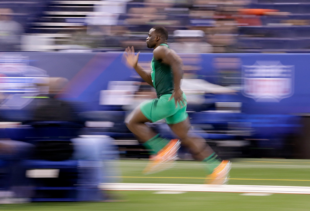 . UCLA defensive lineman Owa Odighizuwa runs the 40-yard dash at the NFL football scouting combine, Sunday, Feb. 22, 2015, in Indianapolis. (AP Photo/Julio Cortez)
