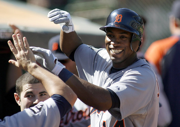 Detroit Tigers' Austin Jackson is congratulated after hitting a solo home run against Oakland Athletics pitcher Guillermo Moscoso in the sixth inning of an MLB baseball game, Sunday, Sept. 18, 2011 in Oakland, Calif.  The homer broke up the A's no-hitter.  (AP Photo/Dino Vournas)