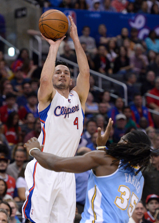 . Clippers#4 J.J. Redick squares up for a shot over Denver #35 Kenneth Faried. The Los Angeles Clippers took on the Denver Nuggets in a regular season NBA game. Los Angeles, CA. 4/15/2014(Photo by John McCoy / Los Angeles Daily News)