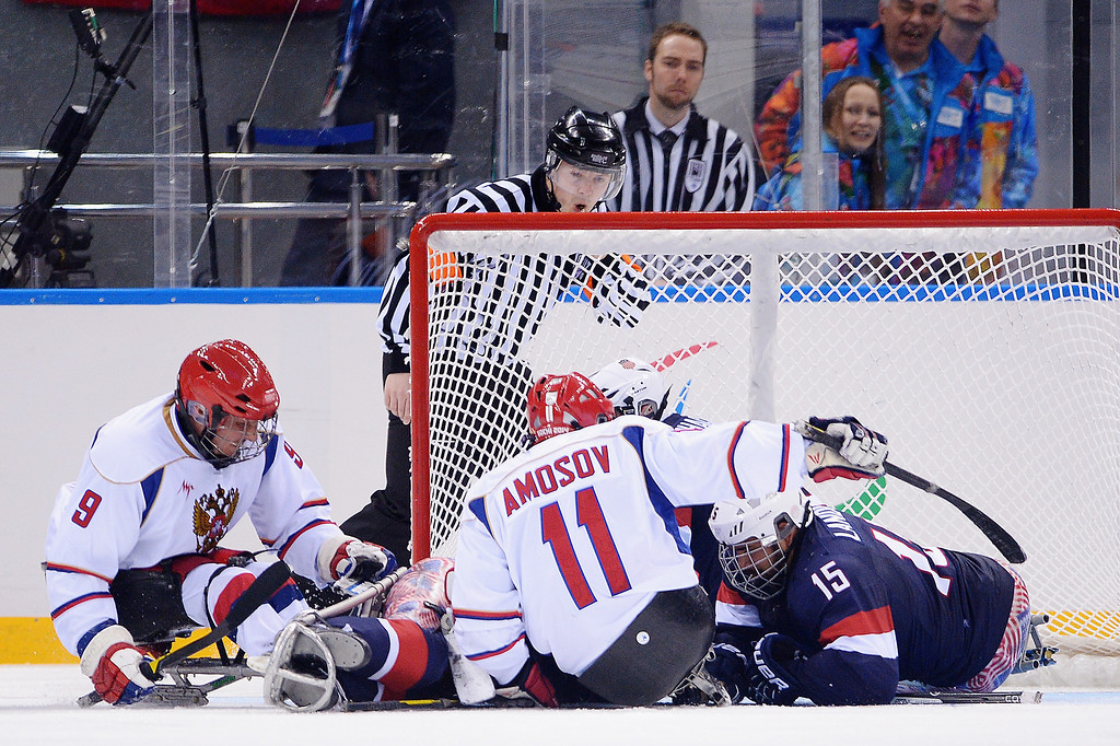 . Alexey Amosov of Russia misses a chance at goal during the Ice Sledge Hockey Preliminary Round Group B match between the United States of America and Russia during day four of Sochi 2014 Paralympic Winter Games at Shayba Arena on March 11, 2014 in Sochi, Russia.  (Photo by Dennis Grombkowski/Getty Images)