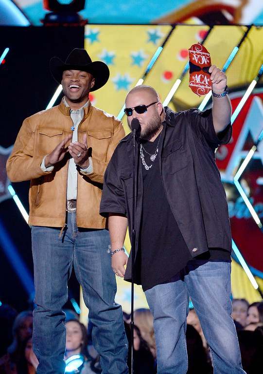 . Presenters Cowboy Troy (L) and Big Smo speak onstage during the 2013 American Country Awards at the Mandalay Bay Events Center on December 10, 2013 in Las Vegas, Nevada.  (Photo by Ethan Miller/Getty Images)