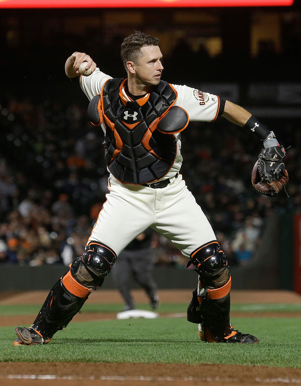 . San Francisco Giants catcher Buster Posey throws a runner out at first base during a baseball game against the Cleveland Indians in San Francisco, Tuesday, July 18, 2017. The Giants won 2-1 in ten innings. (AP Photo/Jeff Chiu)