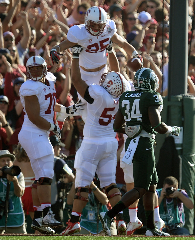 . Stanford\'s Tyler Gaffney #25 celebrates scoring a touchdown against Michigan State during the 100th Rose Bowl game in Pasadena Wednesday, January 1, 2014. (Photo by Hans Gutknecht/Los Angeles Daily News)