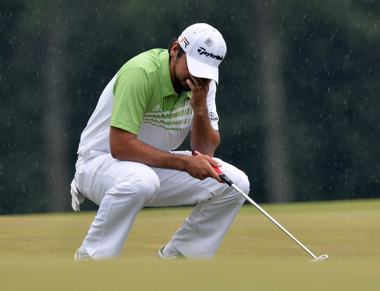 . Jason Day of Australia reacts during the fourth round of the 77th Masters golf tournament at Augusta National Golf Club on April 14, 2013 in Augusta, Georgia.  JEWEL SAMAD/AFP/Getty Images