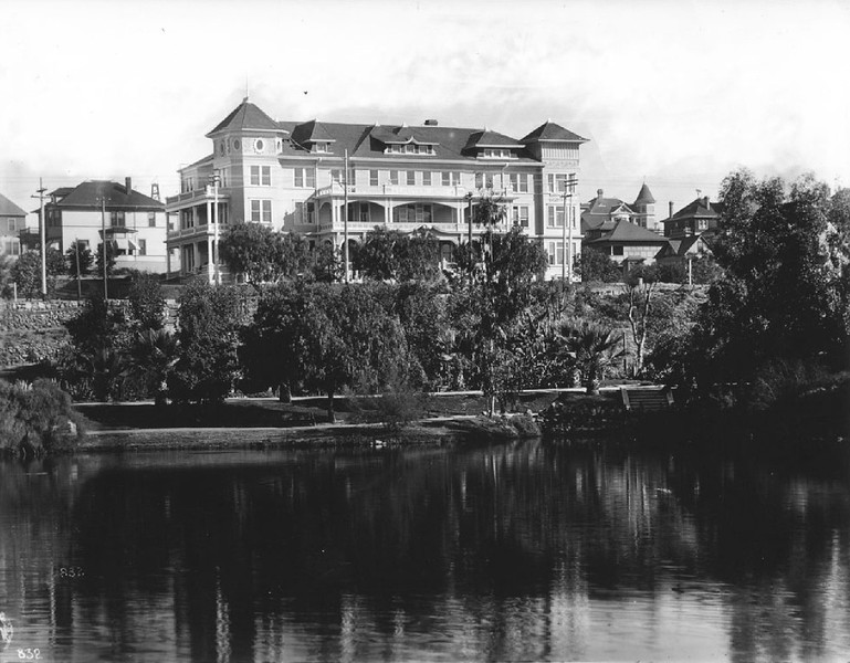 Exterior of the Park View Hotel (Lake View Hotel?) overlooking Westlake Park (later MacArthur Park), as seen from the lake, Los Angeles, ca.1908