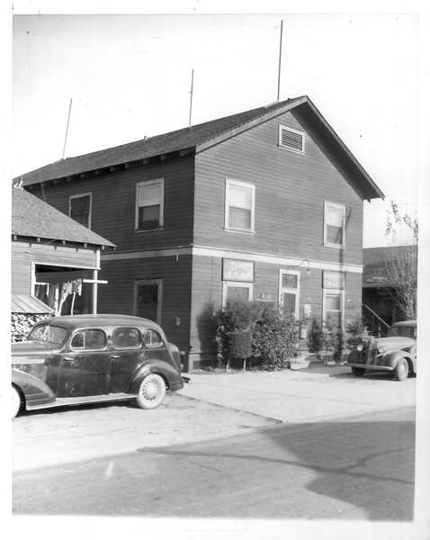 """""""The building housing the Japanese Society and Japanese South Coast Herald, pro-American-Japanese language newspaper, located on Tuna Street on Terminal Island.""""--caption on photograph"""