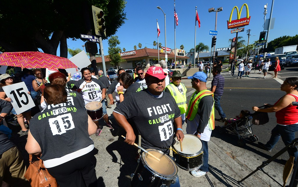 . Fast food workers and their supporters take part in a nationwide strike outside a McDonald\'s fastfood outlet demanding higher wages and the right to form a union on August 29, 2013 in Los Angeles, California, where the fast food restaurant workers were calling for a $15.00 per hour wage.  AFP PHOTO/Frederic J. BROWN/AFP/Getty Images