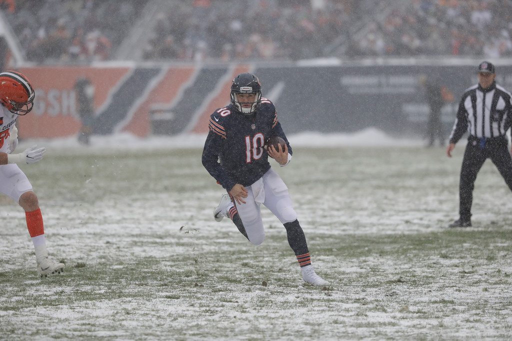 . Chicago Bears quarterback Mitchell Trubisky (10) runs against the Cleveland Browns in the first half of an NFL football game in Chicago, Sunday, Dec. 24, 2017. (AP Photo/Charles Rex Arbogast)