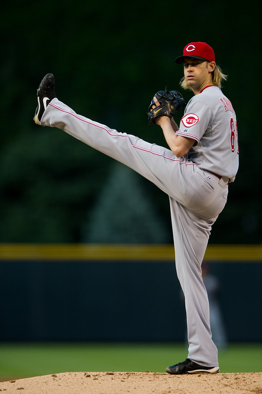 . DENVER, CO - AUGUST 30:  Bronson Arroyo #61 of the Cincinnati Reds winds up to throw a pitch against the Colorado Rockies during the first inning of a game at Coors Field on August 30, 2013 in Denver, Colorado. (Photo by Dustin Bradford/Getty Images)