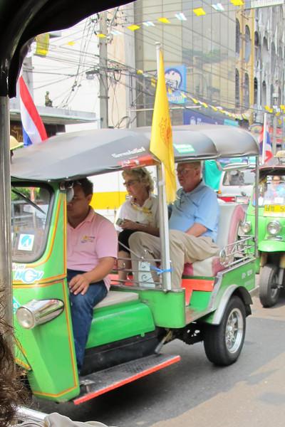 Kitty Walker and Joseph Van De Water in a Tuk-Tuk in Bangkok.