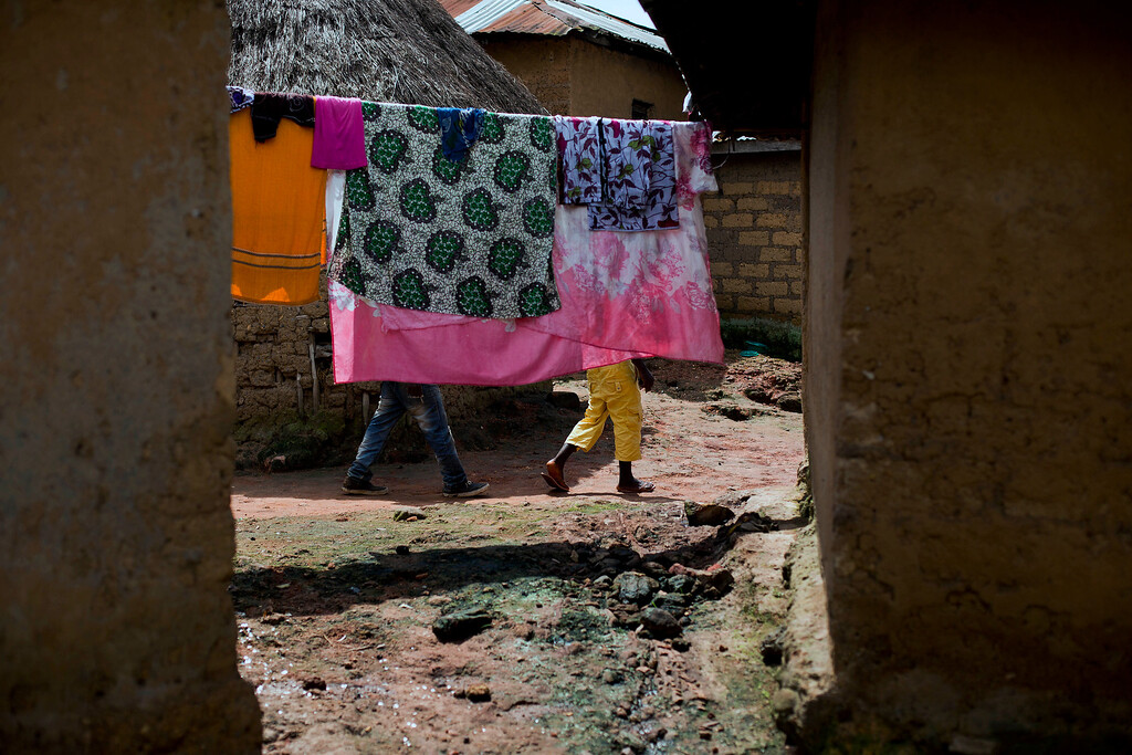 . In this photo taken Thursday Nov. 20, 2014, laundry dries in the Guinean village of Meliandou, some 400 miles (600 mms) south-east of Conakry, Guinea, believed to be Ebola\'s ground zero. (AP Photo/Jerome Delay)