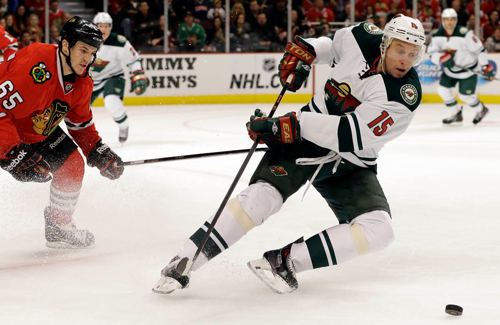 . Minnesota Wild\'s Dany Heatley (15) controls the puck past Chicago Blackhawks \' Andrew Shaw (65) during the second period. (AP Photo/Nam Y. Huh)