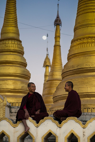 Two monks sitting at the Kan Tau Monastery in Pindaya.  Pindaya, Myanmar, 2017.
