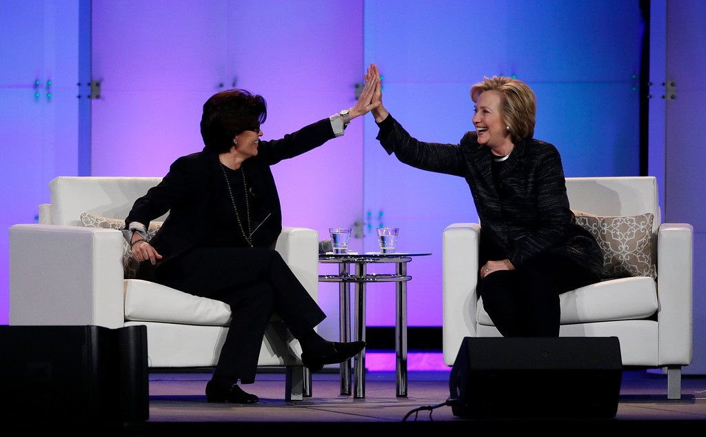 . Hillary Rodham Clinton, right, and technology commentator Kara Swisher high-five during a keynote address at the Watermark Silicon Valley Conference for Women, Tuesday, Feb. 24, 2015, in Santa Clara, Calif. (AP Photo/Marcio Jose Sanchez)