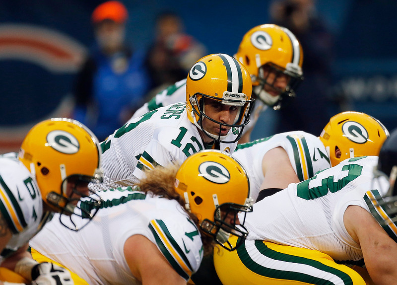 . Green Bay Packers quarterback Aaron Rodgers (12) prepares to take a snap in the first half of an NFL football game against the Chicago Bears in Chicago, Sunday, Dec. 16, 2012. (AP Photo/Charles Rex Arbogast)