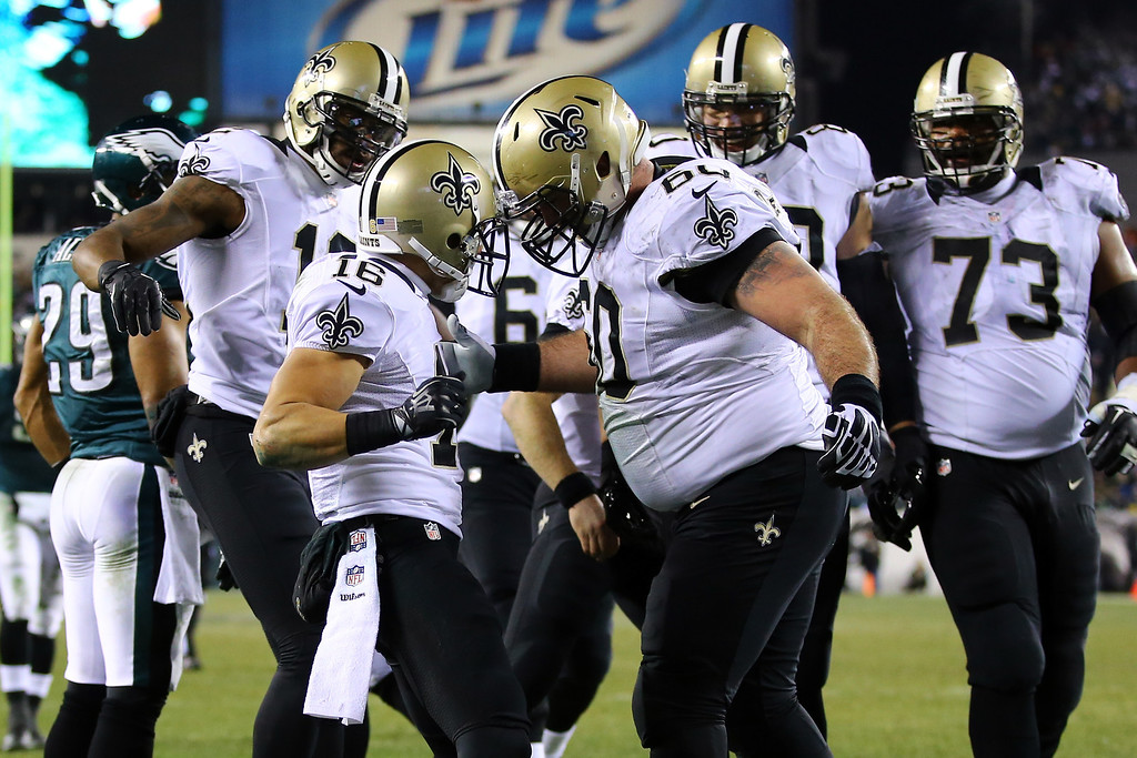 . PHILADELPHIA, PA - JANUARY 04:  Lance Moore #16 of the New Orleans Saints celebrates with teammates Brian De La Puente #60 after scoring a 24 yard touchdown thrown by Drew Brees #9 in the third quarter against the Philadelphia Eagles during their NFC Wild Card Playoff game at Lincoln Financial Field on January 4, 2014 in Philadelphia, Pennsylvania.  (Photo by Al Bello/Getty Images)