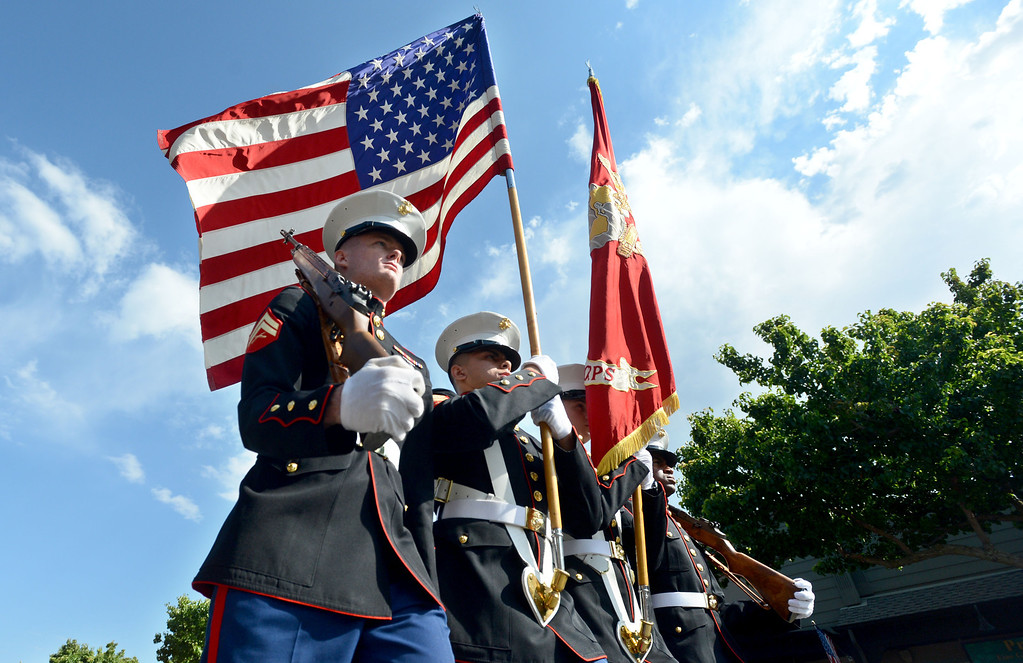 . U.S. Marine Corps color guard, from left, Corporal Preston Barker, Corporal Curtis Plummer, Sergeant Robert Lebron,  and Corporal Charles Smith, march down Hartz Avenue during the 4th of July Parade in Danville, Calif., on Thursday, July 4, 2013. The parade, sponsored by the Kiwanis Club of San Ramon Valley, features about 120 entries with an estimated 40,000 spectators attending. (Doug Duran/Bay Area News Group)