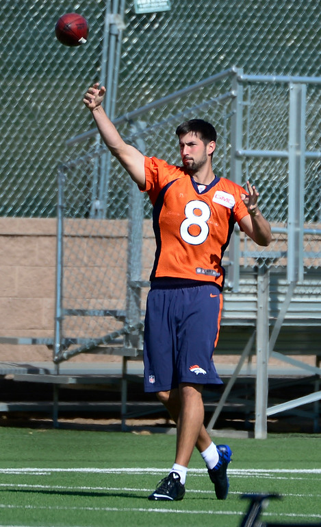 . Kicker Brandon McManus (8) retrieves balls for fellow kickers during practice drills. The Denver Broncos practice at Dove Valley on Monday, Sept. 1, 2014 in preparation for their season opener against the Indianapolis Colts on Sunday night. (Kathryn Scott Osler/The Denver Post)