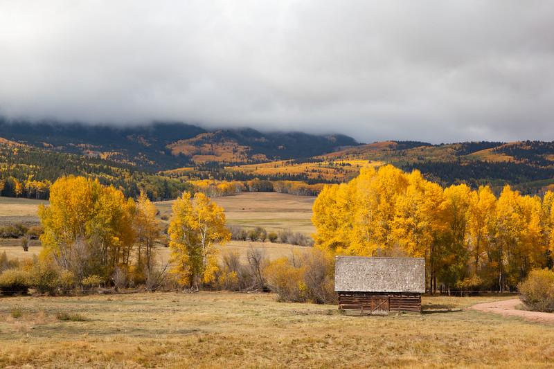 A Colorado Log Barn On A Fall Morning
