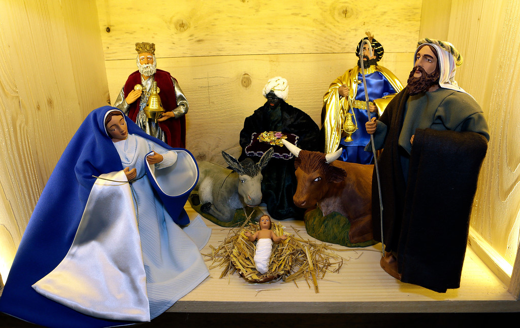 . Christmas crib figures of Mary, left, and three wise men are pictured in the village of Aubagne, near Marseille, southern France, Thursday, Nov. 30, 2017. Craftsmen of the city joined their forces to build a traditional provencal crib that shows 3 500 clay made figurines named santons. Santons are traditional colored figurines usually set in Christmas Nativity scenes. (AP Photo/Claude Paris)