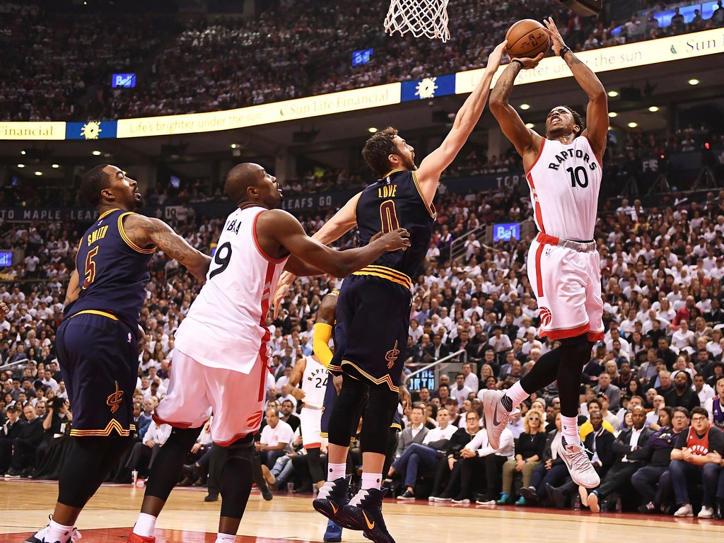 . Toronto Raptors guard DeMar DeRozan (10) has his shot blocked by Cleveland Cavaliers forward Kevin Love (0) as Cavaliers guard JR Smith (5) and Raptors forward Serge Ibaka (9) defend during the first half of Game 3 of an NBA basketball second-round playoff series in Toronto on Friday, May 5, 2017. (Frank Gunn/The Canadian Press via AP)