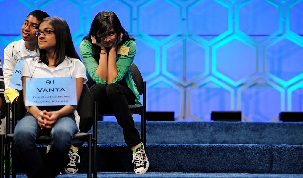 . Syamantak Payra, 12, of Friendswood, Texas, left, Vanya Shivashankar, 11 of Olathe, Kan., center, and Vismaya Kharkar, 14, of Bountiful, Utah wait for their turn to spell a word during the final round of the Scripps National Spelling Bee in Oxon Hill, Md., Thursday, May 30, 2013. (AP Photo/Cliff Owen)